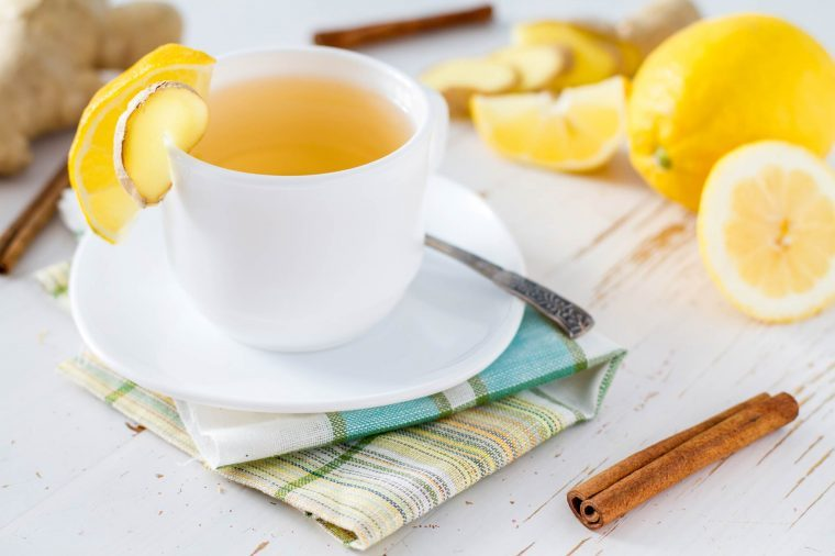 tea in a white tea cup with lemon slices