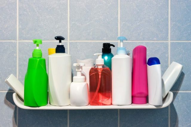 A shower shelf full of hair products