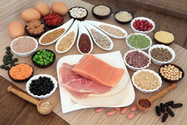 artful assortment of nuts, meats, eggs, and other proteins