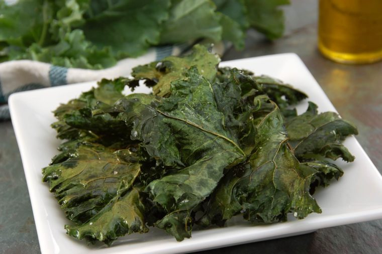 white square plate with kale chips