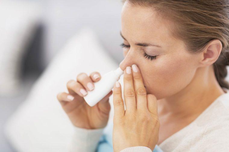 woman using a nasal inhaler