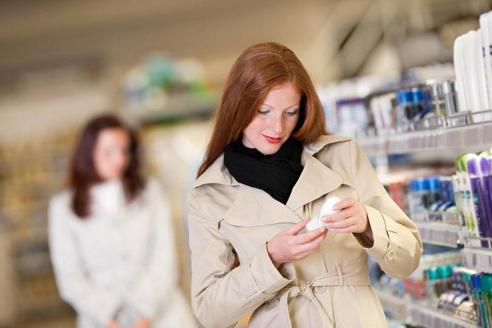 Woman in store buying deodorant