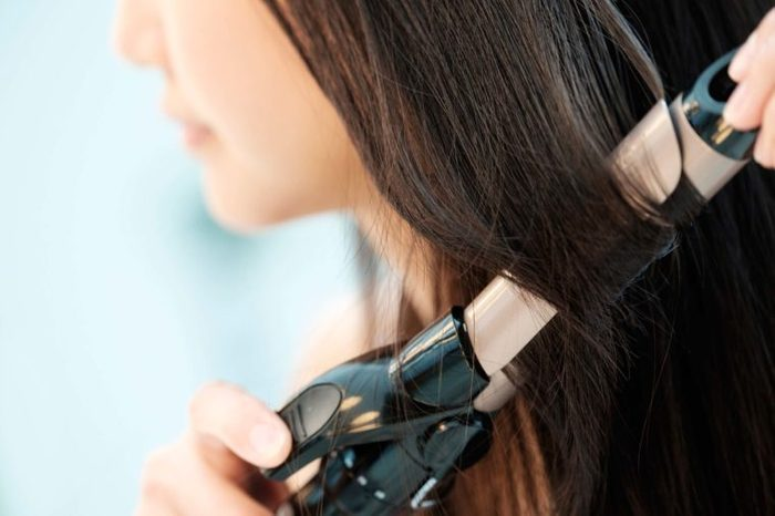woman using a curling iron