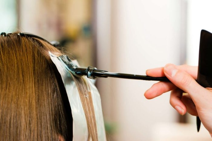 woman getting highlights in her hair