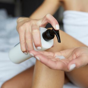 close up of woman pumping lotion into hand