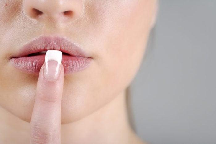 woman finger on lips dry