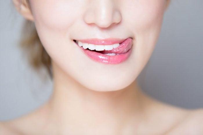 woman licking lips