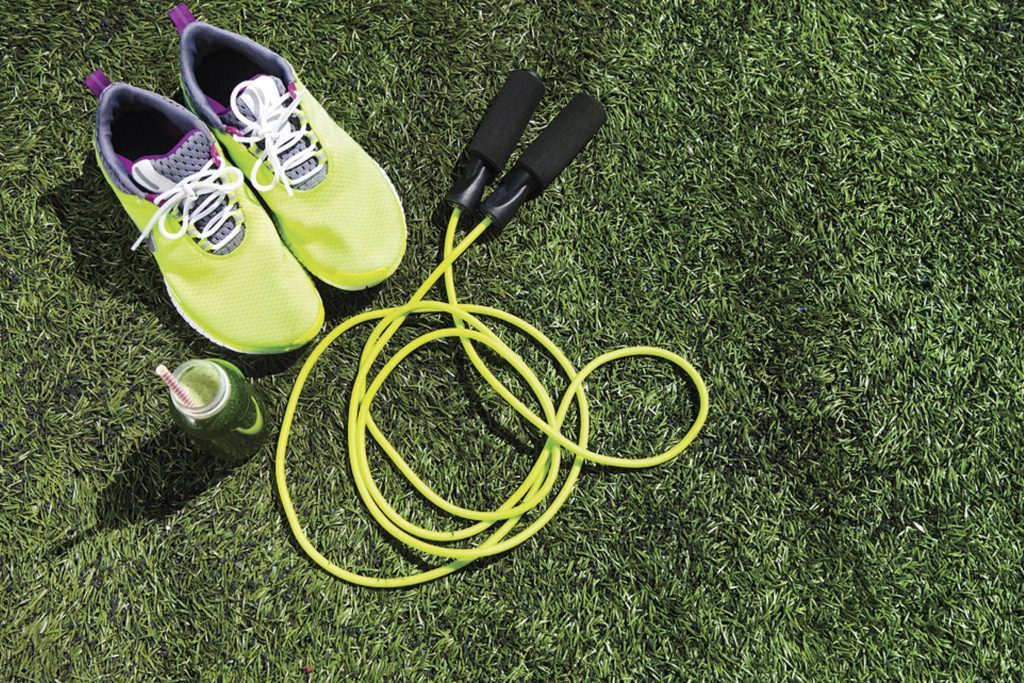 sneakers and a jump rope on grass