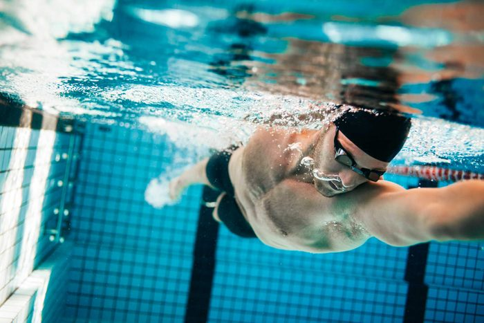 male swimmer doing the crawl stroke in pool