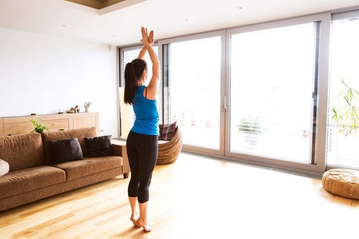 barre3, woman exercising in sunny room