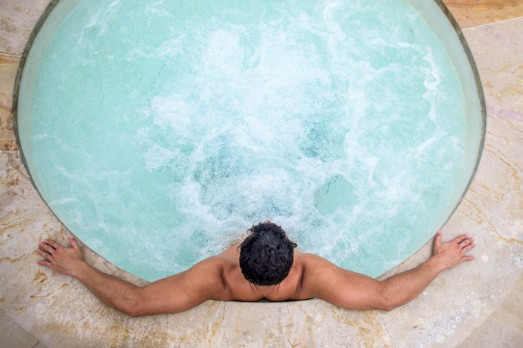 man in a whirlpool hot tub