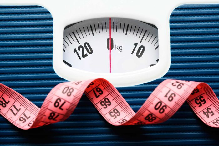 Weight scale with red measuring tape