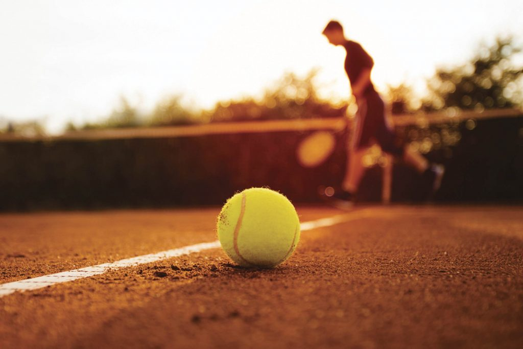 close up of tennis ball on court