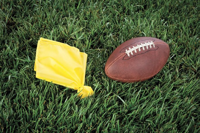 flag and football on grass