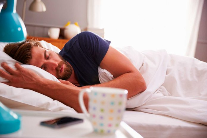 man with beard sleeping