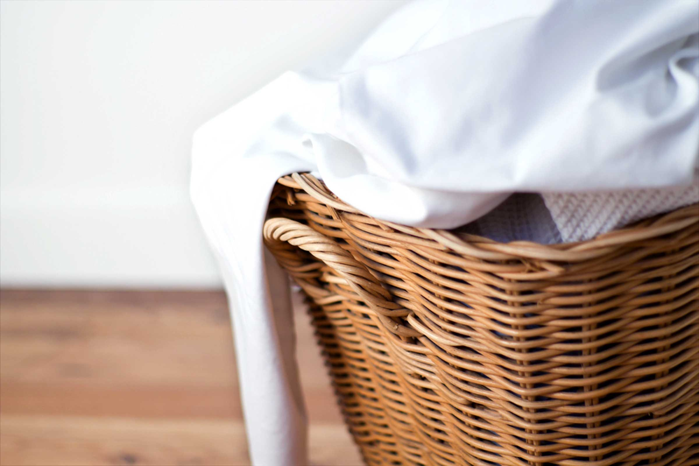 laundry in a wicker hamper