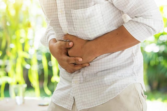 person holding his or her stomach