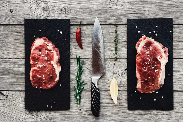meat on cutting board with rosemary