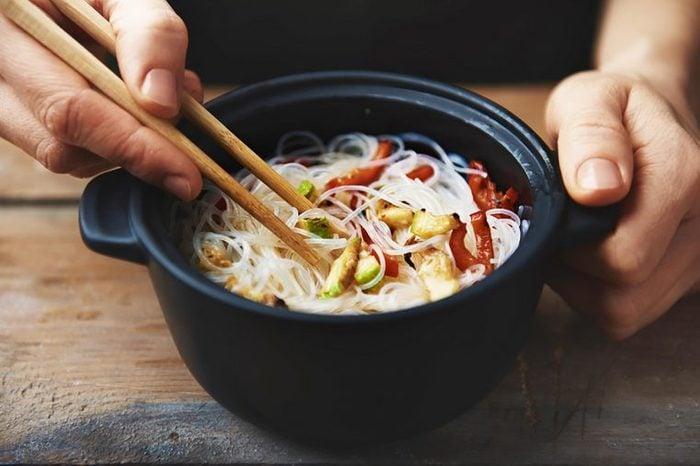chopsticks and noodle bowl