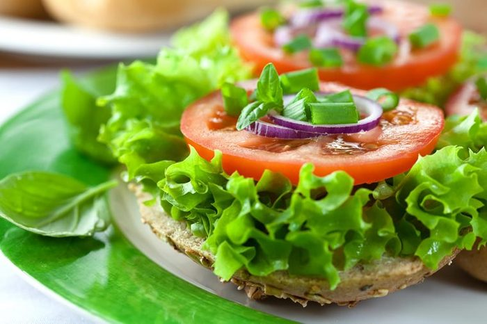 stacked lettuce, onion, and tomato