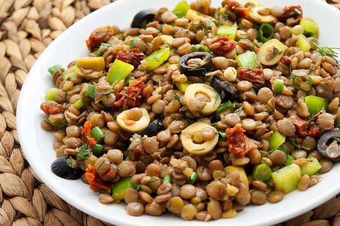 a lentil dish with olives and veggies