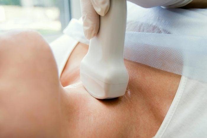 woman getting an ultrasound thyroid scan