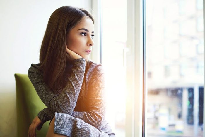 woman contemplating window