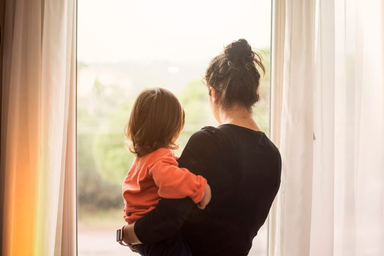 mother and son looking out of window