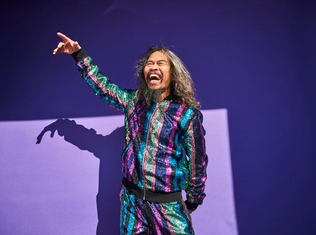 happy man on purple background