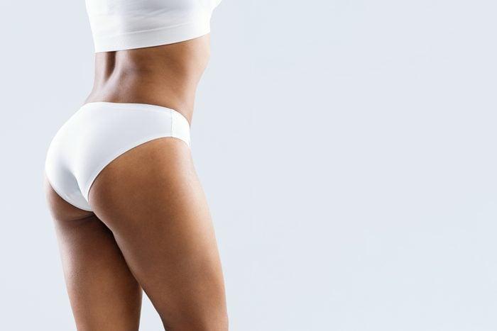 cropped rear view of woman in underwear