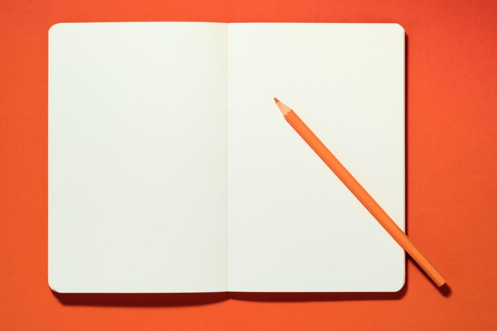 open journal on orange background