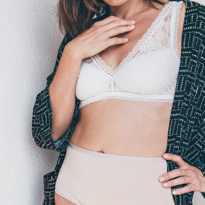 middle aged woman breast bra torso