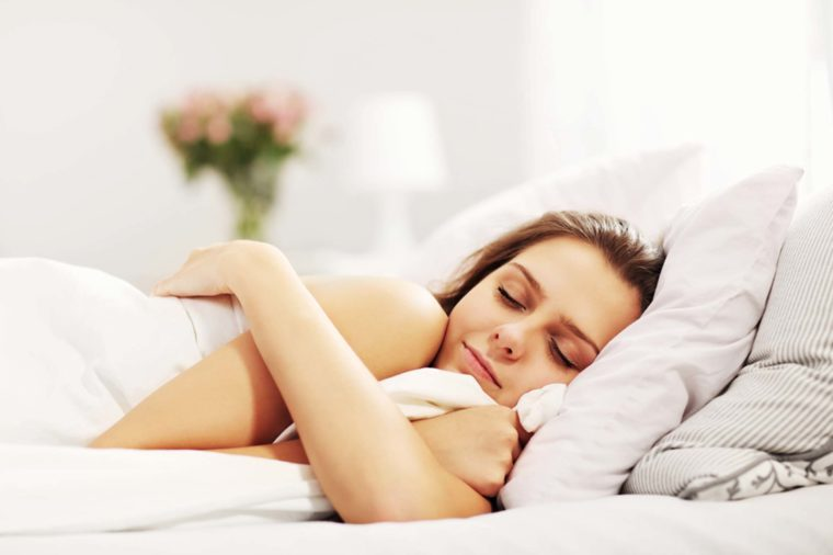 A woman sleeping peacefully in bed.