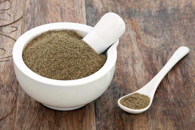 gymnema powder in a mortar and pestle bowl