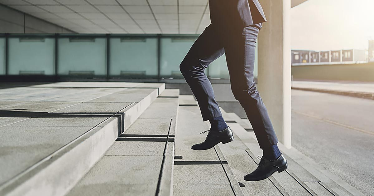 business man running up stairs