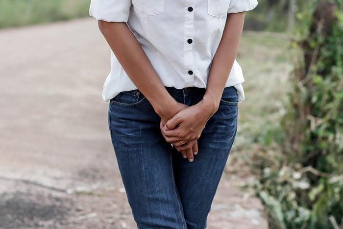 woman's torso with hands below waist