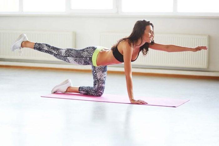 woman holding yoga pose