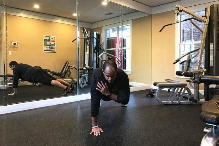 black man doing shoulder taps