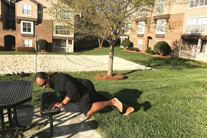 black man doing elevated knees to elbows