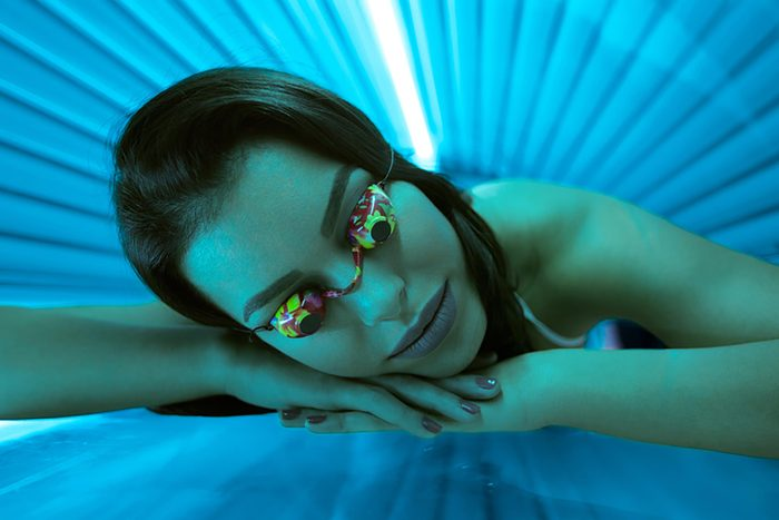 young woman in tanning bed