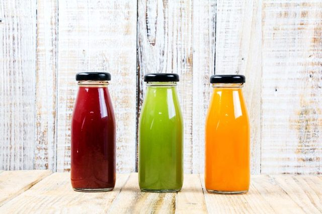 Three bottles of juice: one red, one green and one orange