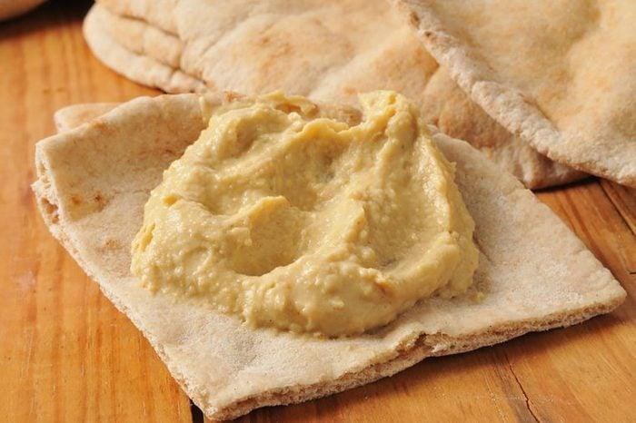Pita chips with hummus.