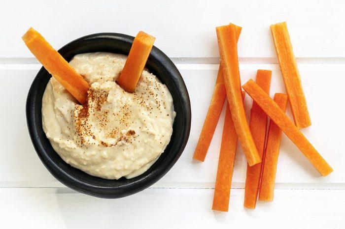 Hummus dip with carrot sticks.