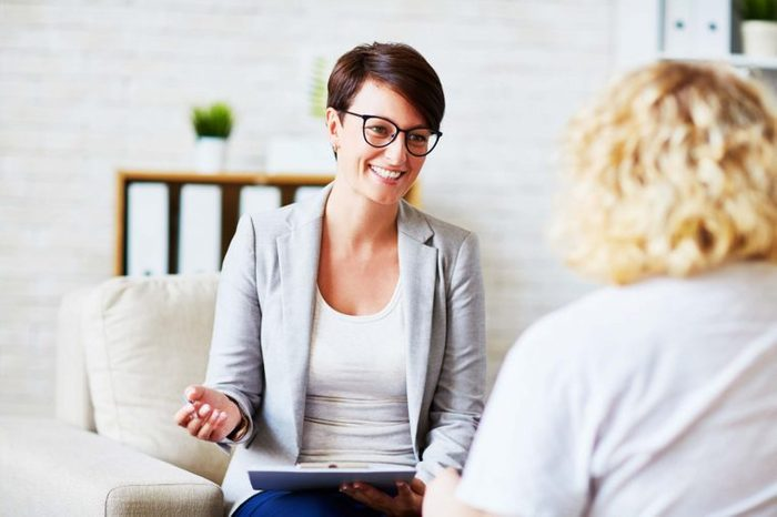 woman talks with counselor