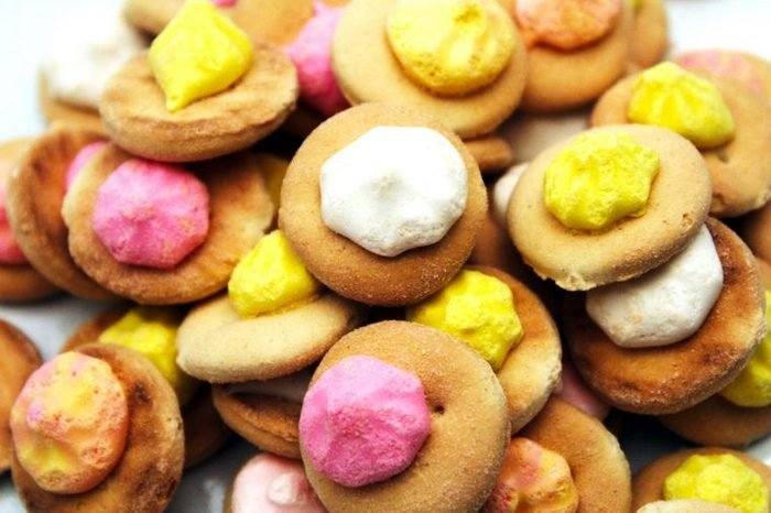Cookies with white, pink and yellow frosting