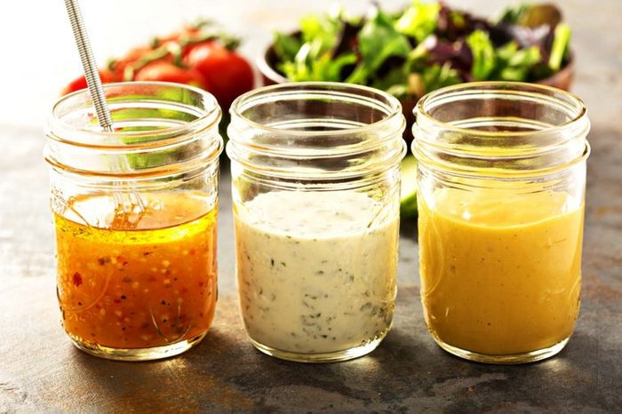 Three jars of different salad dressing