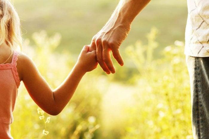 man holding little girl's hand