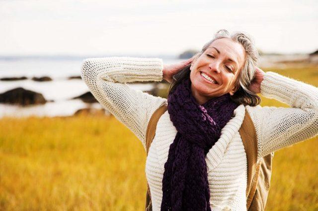 joyful woman outside near water