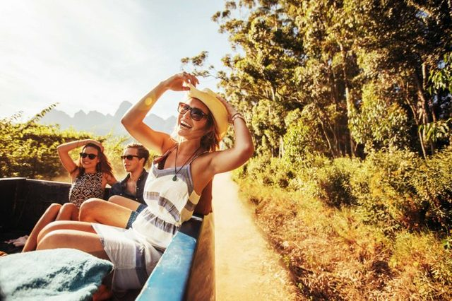 happy woman in sun with friends
