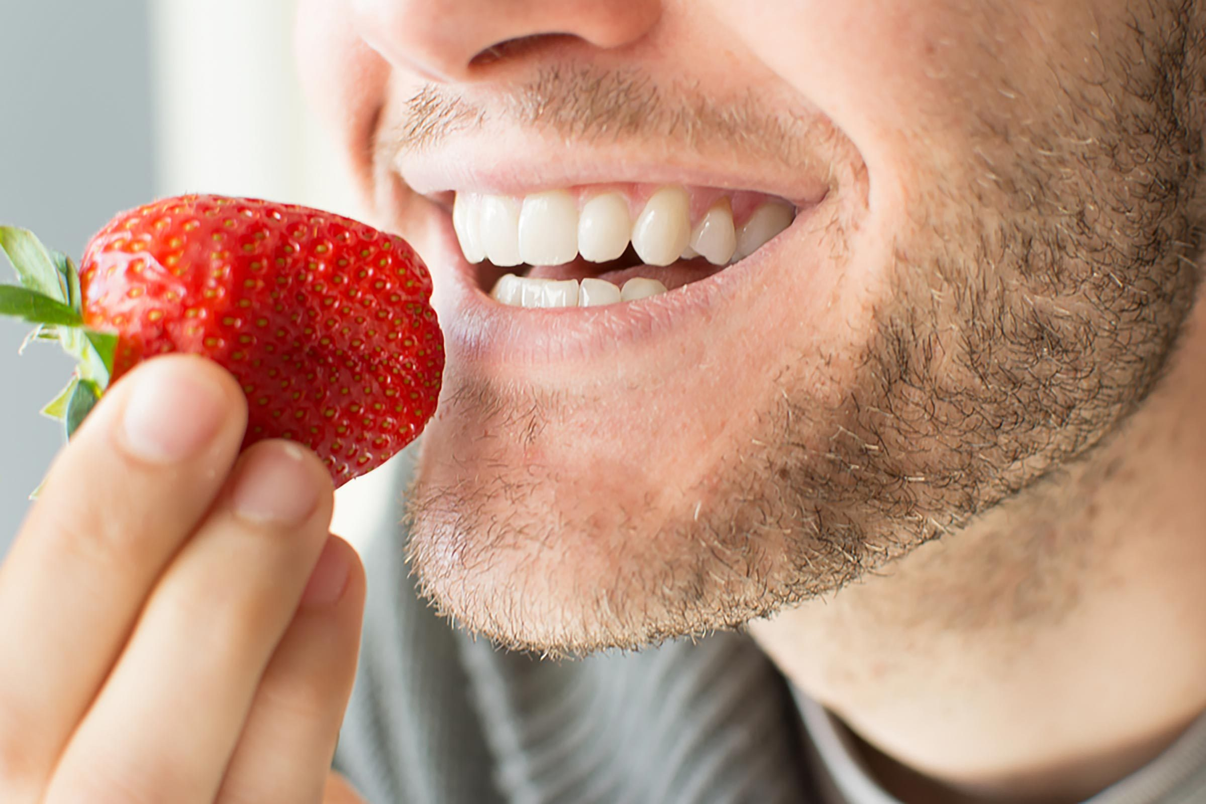 teeth biting a strawberry